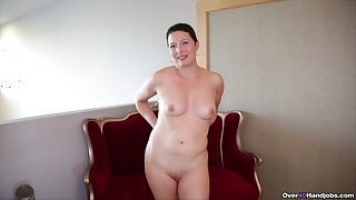 Hasty haired ill-lit wife strips and drops on her knees for a handjob